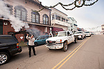 Local Shotgun-toting residents gather their shotguns and handguns to shoot black-power blanks on Jackson, California's Main Street during the annual celebration of Christmas on January 7...Tradition has it that many years ago in the old country, that gunfire announced to the next village the birth of Jesus Christ before telephones and automobiles. This unique tradition continues today in the Mother Lode Gold County...Downtown volley of gunfire in front of the National Hotel.