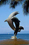 Mexico: Puerto Vallarta.  Dolphin sculptures.  Photo mxpuer102.  Photo copyright Lee Foster, www.fostertravel.com, 510/549-2202, lee@fostertravel.com