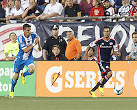 New England Revolution midfielder Diego Fagundez (14) on the attack as Philadelphia Union forward Sebastien Le Toux (11) closes. In a Major League Soccer (MLS) match, the New England Revolution (dark blue) defeated Philadelphia Union (light blue), 5-1, at Gillette Stadium on August 25, 2013.