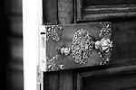 An ornate period metal door handle with lock