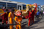 Dragon dancers perform in front of businesses during the Lunar New Year for money in Ho Chi Minh City, Vietnam...Kevin German / LUCEO