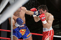 Moscow, Russia, 05/06/2010..Batu Khasikov and Ricardo Fernandes trade blows on the ropes in a world championship kickboxing bout during the new Fight Nights boxing tournament.