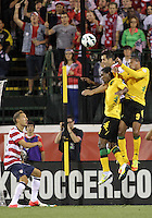 COLUMBUS, OHIO - SEPTEMBER 11, 2012:  Carlos Bocangra (3) of the USA MNT climbs higher than Jason Morrison (7) and Ryan Johnson (9)  of  Jamaica to win a header during a CONCACAF 2014 World Cup qualifying  match at Crew Stadium, in Columbus, Ohio on September 11. USA won 1-0.
