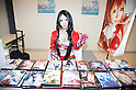 "June 2, 2012, Tokyo, Japan - A Japanese woman dresses as anime character and shows her DVDs at the Moe Culture Festival 2012.  The Anime and Cosplay exhibition ""Moe Culture Festival 2012"" from June 2nd to 3rd at Otaku Sangyou Plaza Pio.."