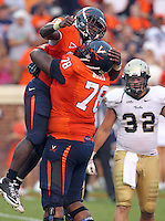 Sept. 3, 2011 - Charlottesville, Virginia - USA; Virginia Cavaliers running back Kevin Parks (25) celebrates a touchdown with Virginia Cavaliers offensive tackle Morgan Moses (78) during an NCAA football game against William & Mary at Scott Stadium. Virginia won 40-3. (Credit Image: © Andrew Shurtleff