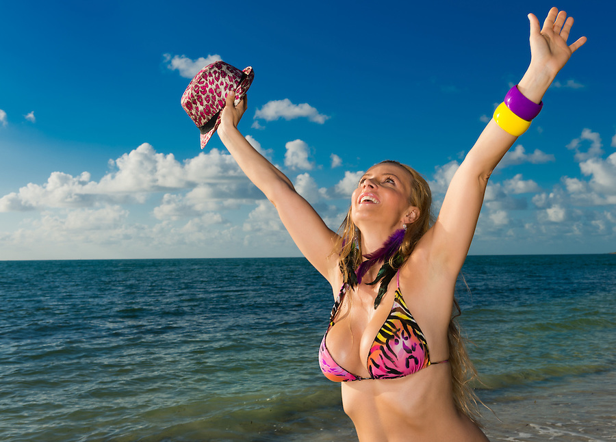 Young caucasian woman very happy and cheerful in the beach