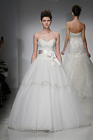 Model walks runway in a Zuzanna wedding dresses by Amsale Aberra, for the Kenneth Pool Spring 2012 Bridal runway show.