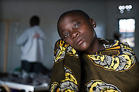 A young girl inside the Medecins Sans Frontieres (MSF) tent in the Kibati camp for displaced people. MSF started a cholera treatment centre after cholera was diagnosed in the local health centre. Due to the new influx of displaced people after violence, Kibati camp is now overcrowded and the water and sanitation situation is deteriorating. An outbreak of cholera could be a further threat to many lives.