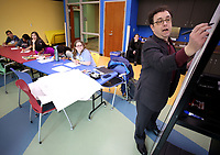 NWA Democrat-Gazette/DAVID GOTTSCHALK  Arie Kaplan, writer and cartoonist, illustrates a humorous snake during a workshop Monday, April 17, 2017, on how to draw magazine-style gag cartoons at the Fayetteville Public Library to middle school students. The lesson focused on using basic shapes, improvisation and creative brainstorming. Kaplan will be speaking for a second night on Jews and the history of Comic Books in America tonight at the University of Arkansas at 7:00 p.m. at the G. David Gearhart Hall on the campus.