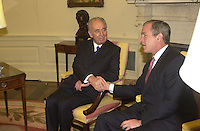 United States President George W. Bush shakes hands with Foreign Minister Shimon Peres of Israel in the Oval Office of the White House. on May 3, 2001<br /> Credit: Ron Sachs / CNP /MediaPunch