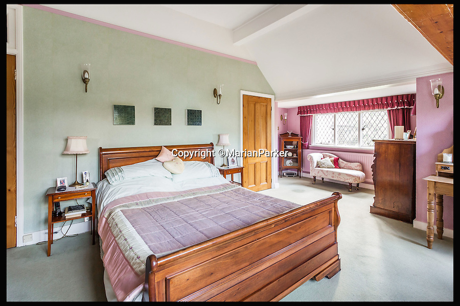 BNPS.co.uk (01202 558833)<br /> Pic: MarianParker/BNPS<br /> <br /> Bedroom.<br /> <br /> Colonial time capsule - Yours for &pound;1 million.<br /> <br /> The finest original bungalow that remains from Victorian time's is for sale - with a lot more style &amp; grandeur than its hum-drum modern descendents.<br /> <br /> Pleasaunce Cottage in East Grinsted has been meticulously maintained over decades to keep much of its original charm with authentic wood panelling and stained glass windows.<br /> <br /> It is said to be the finest example of a colonial India-style bungalow that exists in this country today and features on the Society for the Protection of Ancient Buildings (SPAB) property list.