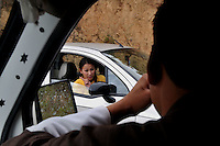 A bhutanese lady driving a car. Bhutan is a new democracy and people are westernising fast. Arindam Mukherjee..
