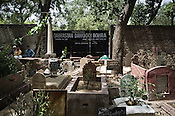 Mourners seen in a graveyard behind the media HQs in ITO, New Delhi, India. Photo: Sanjit Das/Panos