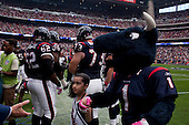 Houston, Texas<br /> October 2, 2011<br /> <br /> Team owner Bob McNair greets a child and the team mascot on the sidelines as the game is about to begin. <br /> <br /> The Houston Texans defeated the Pittsburgh Steelers at the Reliant Stadium 17 to 10.