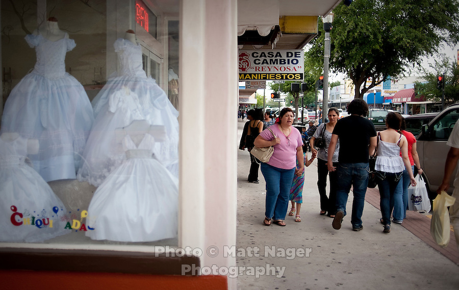 store front advertises children s clothing along Main Street in