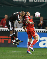 Julius James #2 of D.C. United heads the ball away from Dwayne De Rosario #14 of Toronto FC during an MLS match that was the final appearance of D.C. United's Jaime Moreno at RFK Stadium, in Washington D.C. on October 23, 2010. Toronto won 3-2.