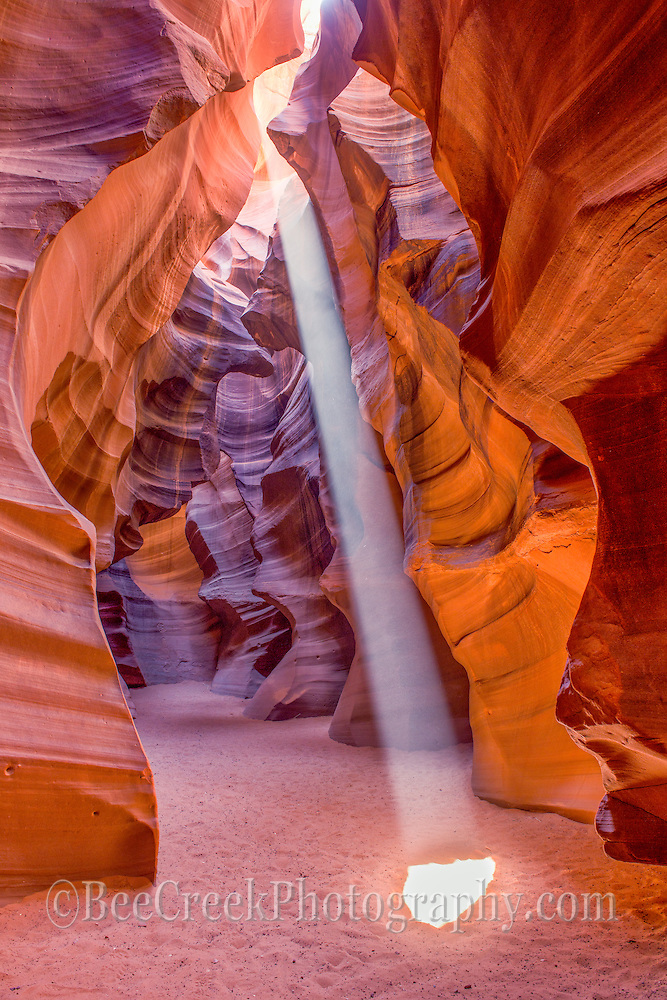 The antelope canyon outside of Page Arizona are incredible sites to see.  The wind and water have formed these slot canyons.  Through all the erosion process they hae exposed the walls of sandstone with the layers expose.  What I love was all the different shapes and colors the waters have expose over time.  It can be a danagerous place if there is rain upstream as eleven people died in Aug 1997 when there was a flash flood upstream that ran into the slot canyons before the people were aware of the situtaion as it was not raining there.  Since then the have install some early warnings signals and the ladders are now bolted into the canyon walls.