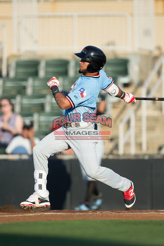 Miguel Aparicio (5) of the Hickory Crawdads follows through on his swing against the Kannapolis Intimidators at Kannapolis Intimidators Stadium on May 18, 2017 in Kannapolis, North Carolina.  The Crawdads defeated the Intimidators 6-4.  (Brian Westerholt/Four Seam Images)