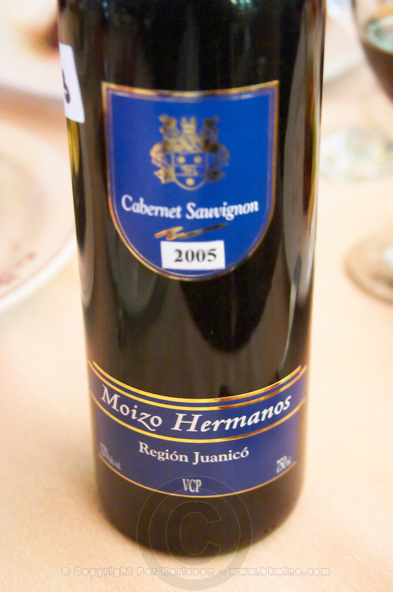 Bottle of Cabernet Sauvignon Moizo Hermanos Region Juanico VCP, in the restaurant El Palenque, the sword fish swordfish, in the Mercado del Puerto, the market in the port harbour harbor where many people go and eat and shop on weekends Montevideo, Uruguay, South America