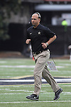 Vanderbilt head coach James Franklin runs off the field during the second half of the University of Kentucky vs. Vanderbilt University football game at Vanderbilt Stadium in Nashville, Tenn., on Saturday, November 16, 2013. Vanderbilt won 22-6. Photo by Tessa Lighty | Staff