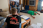 Phillip Griffieon (with back to camera), Nick Griffieon (lying on floor), and a friend preparing for an FFA presentation, Griffieon Family Farm, Ankeny, Iowa.