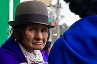 An old Guambiano woman walk on the street during the traditional Indian market in Silvia, Colombia, 8 April 2004. The Guambiano, a South American Indian tribe, live in the southwestern corner of Colombia. There are about 20.000 of Guambianos living in communities close to their capital town of Silvia. Guambianos are traditionally agricultural people. Since the Spanish conquest they have been gradually evicted from their original fertile lands up to the cold, rainy mountains. In spite of the permanent pressure by Colombian society, the Guambiano Indians still speak their original language, keep their colorful clothes and maintain their nature based religious customs.