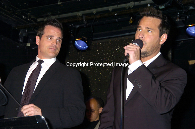Michael Park and Ricky Paull Goldin singing..at The Goldin and Park Cabaret starring Ricky Paull Goldin from Guiding Light and Michael Park from As The World Turns. Kim Zimmer, Robert Newman and Mandy Bruno also sang. This was at The Triad NYC on April 16, 2005, and  was a benefit for Bill Runyon's family. ..Photo by Robin Platzer, Twin Images