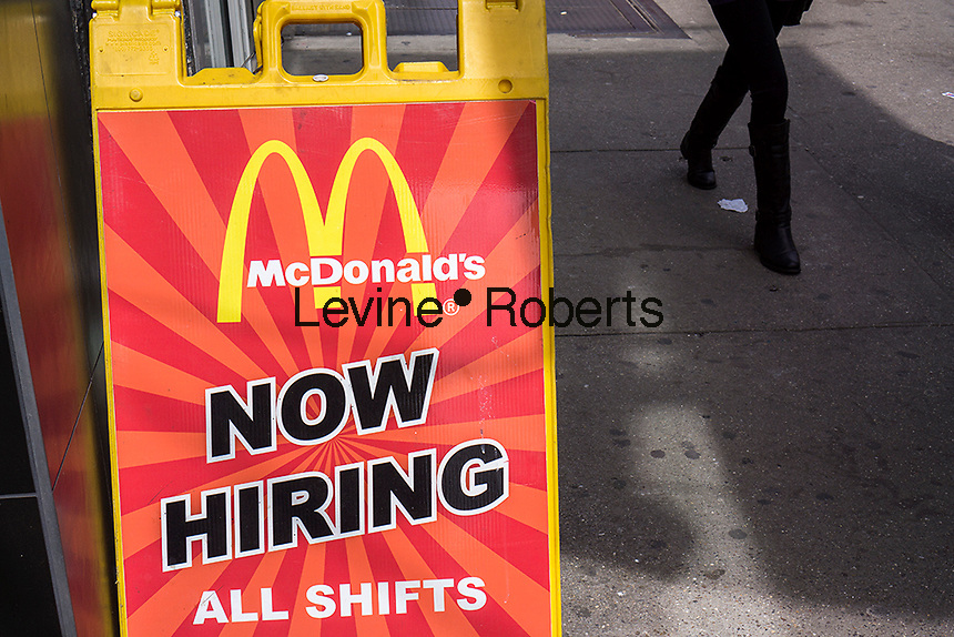 A sign outside of a McDonald's restaurant in New York on Sunday, March 24, 2013 announces that it is hiring. (© Richard B. Levine)