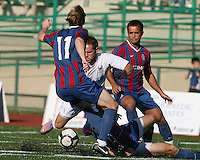 Neil Vranis #11 of Crystal Palace Baltimore moves in on Daniel Paladini #11 of the Carolina Railhawks during an NASL match at Paul Angelo Russo Stadium in Towson, Maryland on September 18 2010. Carolina won 4-2.