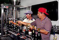 A PORTABLE WINE BOTTLING PLANT (housed in a semi truck) at work in a CALIFORNIA WINERY