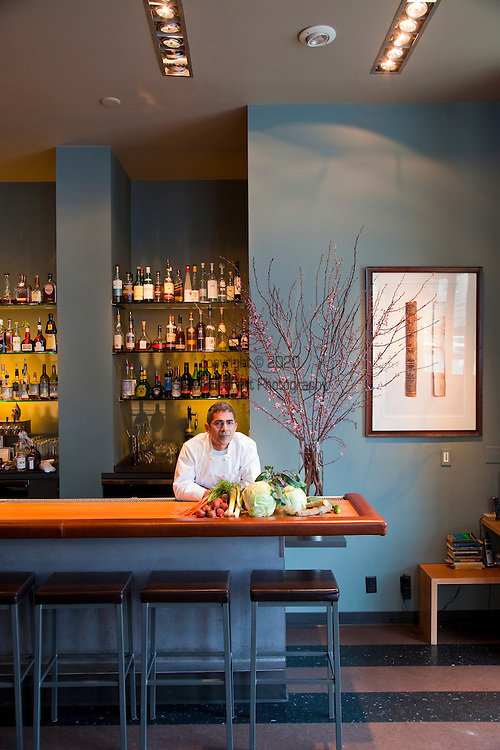 chef/owner Chris Israel in his downtown restaurant, Grüner showing off many of the raw ingredients that he uses for pickling