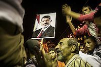 In this Thursday, Aug. 01, 2013 photo, supporters of the ousted president Mohammed Morsi chant slogans during a demonstration after prayers at the sit-in of Cairo University, in the Giza district. (Photo/Narciso Contreras).