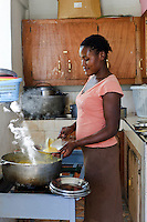 Cook at an orphanage supported by EDV, Port-au-Prince, Haiti. EDV is committed to affecting permanent change in disaster-affected communities worldwide. Their role is to facilitate personal connections between volunteers and the survivors of disasters.  The charity is based on a proven model developed by several landmark organisations that have paved the way for citizens to become disaster volunteers. These landmark organisations have shown that supposedly ordinary people working together with the guidance of knowledgeable leaders can make an extraordinary difference in the lives of those affected by disaster..EDV believe that to provide meaningful relief and reconstruction assistance to disaster affected communities they have to do more than reconstruct buildings. They need to understand and address the factors that made a community vulnerable to the disaster in the first place. The charity's work is organised with these factors in mind so that they can affect change that far outlives their presence..EDV believes that survivor motivation is essential to the recovery of any disaster-affected community. Their operations will always be predicated on the idea that survivors may be traumatised, but they are not helpless. With this in mind, EDV encourages host communities to direct their own recovery. EDV believe that this empowerment is essential in helping survivors feel a renewed sense of control over their lives which will, in turn, help overcome the feelings of hopelessness that can follow a disaster and inhibit long term recovery. EDV also believe that social cohesion is of primary importance in any disaster-affected area. No amount of bricks or mortar will bring about sustainable improvement if communities fail to come together or are disrupted by relief efforts. Therefore, their operations will always aim to foster communication and cooperation within and between the communities they serve.