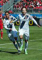 30 March 2013: Los Angeles Galaxy forward Mike Magee #18 celebrates his goal with Los Angeles Galaxy midfielder Marcelo Sarvas #8 during an MLS game between the LA Galaxy and Toronto FC at BMO Field in Toronto, Ontario Canada..The game ended in a 2-2 draw..