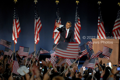 Chicago, IL - November 4, 2008 -- United States President-elect Barak Obama waves to supporters before speaking in Lower Hutchinson Field, Grant Park, Chicago, Illinois after his election as President of the United States on Tuesday, November 4, 2008..Credit: Ron Sachs / CNP