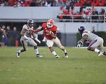 Georgia running back Todd Gurley (3) vs. Ole Miss linebacker Denzel Nkemdiche (4) at Sanford Stadium in Athens, Ga. on Saturday, November 3, 2012.