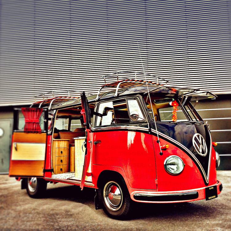 Vintage Split screen VW Samba camper van in red and blue paint with open doors