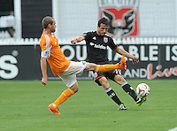 Washington D.C. - May 17, 2014: Cristian Fernandez (3) of D.C. United goes against Brian Ownby (22) of Houston Dynamo.  D.C. United defeated  the Houston Dynamo 2-0 during a Major League Soccer match for the 2014 season at RFK Stadium.