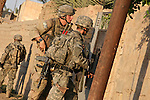 Sgt. Rusty Christian, 21, of Greenville, Tenn., and Spc. Sean Wilson, 21, of Jacksonville, Fla., of Company C, 1st Battalion, 23rd Infantry Regiment enter the courtyard of a house during a U.S.-led offensive to clear insurgents from Baqubah, Iraq. Christian was killed three years later in Afghanistan while serving in the Special Forces.  June 21, 2007. DREW BROWN/STARS AND STRIPES