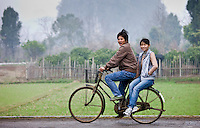 Young people on a bicycle near Guilin, China
