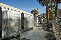 Exterior view of mid-century style home with movable aluminum walls