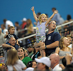 A little girl hopes to have a T-shirt thrown her way during a promotion between innings of a game on May 13, 2010, at Fluor Field at the West End in Greenville, S.C.