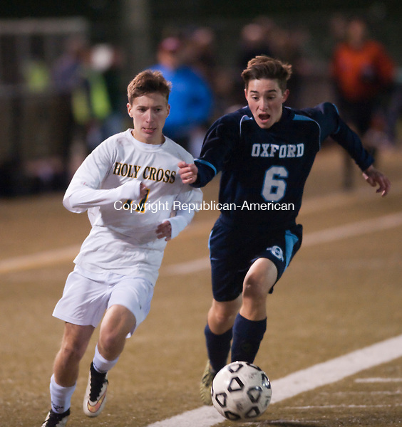WATERBURY, CT--- -102615JS16--Holy Cross' Diogo Taveria (11) and Oxford's Timothy Flach (6) battle for the ball -during their game Monday at Municipal Stadium in Waterbury. <br />  Jim Shannon Republican-American