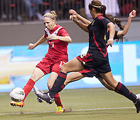 iBrittany Timko, left, of Canada takes a shot on goal past two Mexico defenders in the CONCACAF Olympic Qualifying semifinal match at BC Place in Vancouver, B.C., Canada Friday Jan. 27, 2012. Canada won the match 3-1 to earn a berth in 2012 London Olympics.