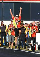 Nov 13, 2016; Pomona, CA, USA; NHRA pro stock motorcycle team owner George Bryce celebrates during the Auto Club Finals at Auto Club Raceway at Pomona. Mandatory Credit: Mark J. Rebilas-USA TODAY Sports