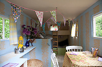 The interior of a caravan is kitted out for children's use with two sets of bunk beds