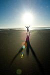 Figure and shadow at Cannon Beach, OR