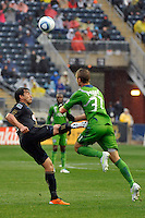 Jeff Parke (31) of the Seattle Sounders FC collides with Carlos Ruiz (20) of the Philadelphia Union during a Major League Soccer (MLS) match at PPL Park in Chester, PA, on April 16, 2011.