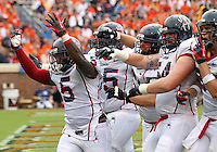 Richmond Spiders fullback Kendall Gaskins (5) celebrates his touchdown with teammates during the 2nd half of an NCAA football game against the Virginia Cavaliers Saturday September, 1, 2012 at Scott Stadium in Charlottesville, Va. Virginia defeated Richmond 43-19.  Photo/The Daily Progress/Andrew Shurtleff