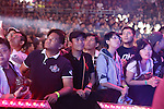 Fans watch aghast as fighters battle it out in the cage<br />